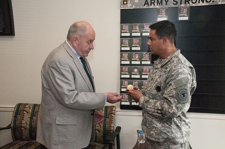cleveland mayor tom rowland accepts a challenge coin from us army recruiting battalion atlanta commanding officer